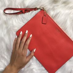 Authentic Coach Large Red Clutch Authentic coach clutch! Beautiful bright red leather with gold hardware. Used once for a Valentine's Day dinner so in new condition! Comes with detachable Wristlet strap. Coach Bags Clutches & Wristlets
