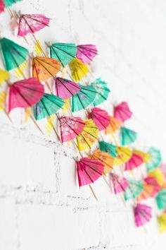 Paper drink umbrella party backdrop: Photography : Milou & Olin Read More on SMP: http://www.stylemepretty.com/living/2016/07/20/this-tropical-party-is-giving-drink-umbrellas-a-genius-new-twist/