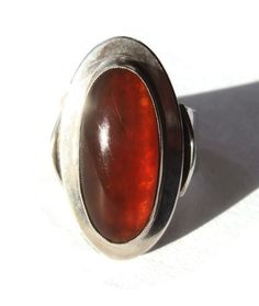 A striking vintage N E From modernist Baltic amber ring, made by the renowned Danish jeweller and silversmith Niels Erik From. This is a wonderful