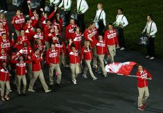 Parade of Nations - Canadian Olympic team. Go Team Canada! So proud of Simon Whitfield, Canada's flag barrier!