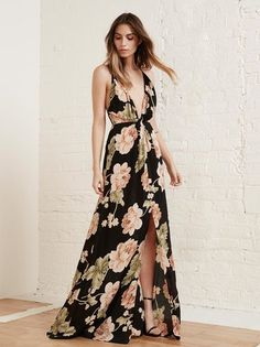 Friends don't make friends wear ugly dresses. This is a floor length, fitted dress with a plunging neckline and a high slit.