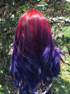 Ombre starting with red violet into purple then deep blue hair colors. Fun abstract colors for the summer!