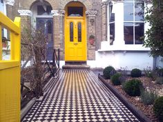 One of our recently installed victorian mosaic paths, edged with rope twist. A refurbished front door and gate. We planted the front garden in a simple design of Box balls, Hidcote lavendars and a central bay tree. For a similar front garden makeover. Victorian Front Garden, Victorian Front Doors, Victorian Terrace House, Victorian Townhouse, Victorian Tiles, Yellow Front Doors, Front Door Colors, House Front Door, Bay Tree Front Door
