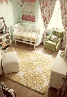 Comfy baby room. LOVE the rug & arm chair. Love the color scheme-if we have a girl we wouldn't have to paint over the blue wall.