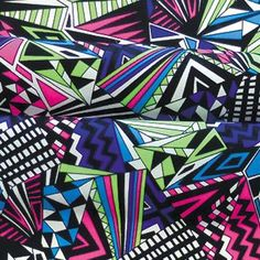 Colorful digital prints remain in style, challenging textile designers to come up with intricate geometric patterns http://www.apparelnews.net/photos/galleries/2013/feb/20/fractal/