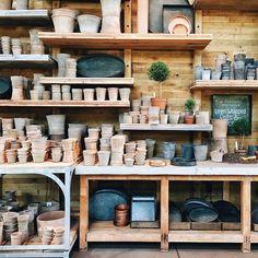 back wall retail shelving ideas: shelves above a table