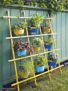 Herb garden, interesting idea using the bucket and S hooks - great way to display pots without taking up a bunch of space