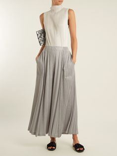 Click here to buy Pleats Please Issey Miyake Pleated wide-leg trousers at MATCHESFASHION.COM