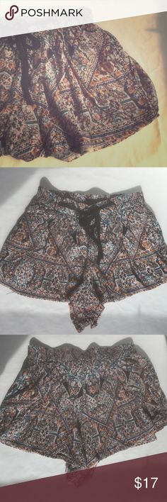 Tribal Pattern Shorts These ultra soft and flowy shorts are super figure flattering and are pocketed. They feature an elastic waist with front tie string. 100% rayon.    Measurements: 13.5 inch waist and 1.5 inch inseam. • These shorts are in great used condition and have no holes or stains. Angie Shorts