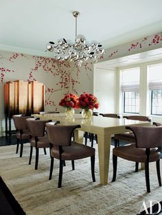 Hand-painted de Gournay wallpaper enlivens the dining room, where a vintage chandelier from Charles Paris Lighting is suspended over a Karl Springer table and Grosfeld House chairs; the copper-leafed cabinet by Pedro Sousa is from Decoratum, and the vintage rug is from Nilufar. | archdigest.com