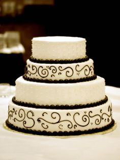 black and white cakes pictures | black cake with swirls and bow, 3 tier