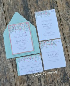 Colorful panel pocket invitation in coral, pink and mint green - perfect for a spring wedding. By Lucky Invitations