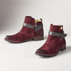 Cute boots.  I like the rich suede color with the contrast strap around the ankle.  And of course the low heel.