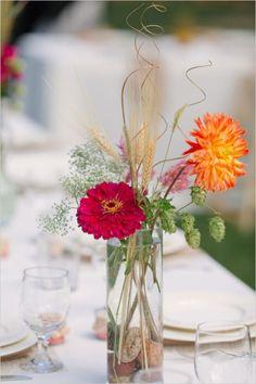 simple wildflower centerpieces #tabledecor #weddingchicks http://www.weddingchicks.com/2013/12/19/funky-farm-wedding/