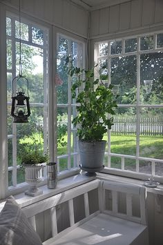 Pretty Swedish White Back Gassed Porch With Hanging Lantern in Summertime