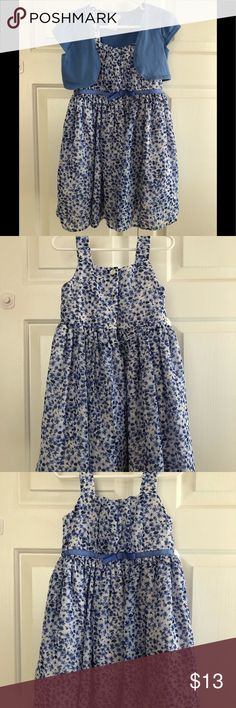 Sleeveless Dress with Cardigan Sleeveless white dress with blue flower print, gathered at waist with blue attached ribbon front and ties in back with button down closure. Blue short sleeve cardigan. Youngland Dresses Casual