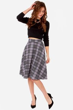 """As Seen On Jenny of Plane Pretty blog! You've got your favorite heels, and you just found a cute top, time to introduce them both to the Me Tartan You Jane Grey Plaid Midi Skirt! This woven medium-weight skirt has a grey plaid pattern including black, ivory, and slate, giving its fitted waistline and flared silhouette more dimension and character. A single grey button secures the waistline. Hidden back zipper. Full stretch-knit lining. Model is 5'8"""" and wearing a size X-Small. 100% ..."""