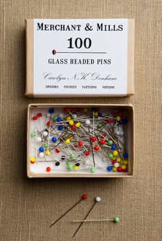 Glass Headed Pins from Merchant & Mills: Lovely Glass Headed Pins come in a rainbow of colors to suit your every mood! And on a more practical front, bright glass heads are easy to find in your fabric, so no unexpected pricks! Each pin is a little over an inch long and each box contains 100 pins.  $9.00