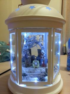Christmas nativity in a Ikea Rotera lantern - Now if you replace Jesus & Co. with snowmen and pinetrees... ;)