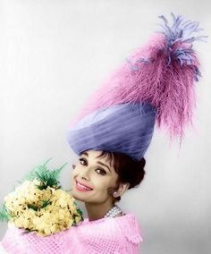 """Audrey Hepburn modeling an extra's costume by Cecil Beaton for """"My Fair Lady"""" 1963."""