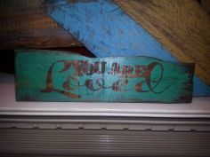 Painted and stained sign made from scraps of wood pallets. Sells for $8 plus any shipping charges. Item # 156