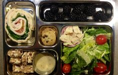 Turkey and cheese rollup, chicken Caesar salad, blackberries, cranberry almond bites, 2 mini chocolate chip cookies.