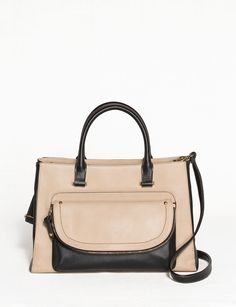 0435ab76ade Say hello to your new favorite everyday purse! It has multiple carrying  options, and is roomy enough to carry all your necessities and then some.