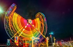 low light photography - carnival. looooove it. such great use of color.