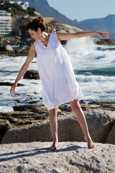 Linen Peasant dress. Made for that everlasting feel of summer and youthfulness. This is perhaps the most fitting selection if you are buying your first item of linen clothing. This is a sleeveless loose-fitting dress with inseam pockets. The silhouette is crisp and clean.  French peasant dress. Flax plant. Cape Town. Africa. Women Fashion. Natural clothing. Freedom. Linen clothing. Flax Plant, Natural Clothing, Cape Town, Clothing Items, The Selection, Crisp, Going Out, Freedom, Africa