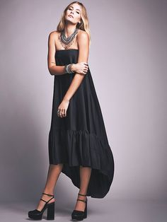 Tube Maxi Dress   Strapless maxi dress featuring a shapeless silhouette with ruffled hem. Side zip with hook-and-eye closures for easy fit. Slit pockets and high-low hem.