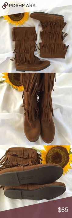Minnetonka 3 layer fringe boots Like new Minnetonka 3 layer suede fringe boots are so trendy and ready for Fall! No signs of wear expect bottom of shoes. Measurements: 11.5 inch boot shaft & 15 inch calf circumference. Color is Dusty Brown. Minnetonka Shoes Moccasins