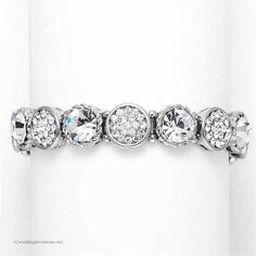 Bracelet Crystal Disks Bridal Stretch Style Bracelet for the wedding or prom that is designer inspired and measures 1/2 inches wide.  The bridal stretch bracelet by Mariell features alternating silver rhodium disks with Crystal solitaires and crystal pave.  This shimmering Wedding or Prom bracelet will add sophisticated bling to your special day