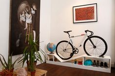 Bike Storage That's Actually Gorgeous Furniture — Design News (Apartment Therapy Main) Indoor Bike Rack, Indoor Bike Storage, Bicycle Storage, Bicycle Rack, Indoor Bike Stand, Bicycle Stand, Bike Storage Bookshelf, Bike Storage Furniture, Furniture Design