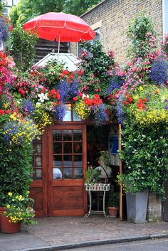 "Churchill Arms-    Kensington Church Street, London: See how you can transform an area from something ordinary into something ""Extra""ordinary! Just takes a little ""Extra"" in the gardening and flower department! Great example here and GREAT curb appeal! Another great example too of what we call a ""Parade Of Gardens""!"