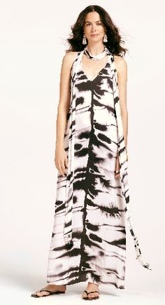 This Palmira dress is an elegant racerback maxi dress.  The black and white print is inspired by a hand painting.