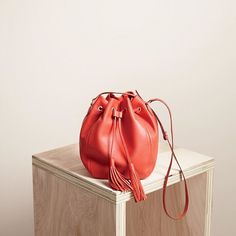 Because red's your color. (Shop the tassel-tie bucket bag in smooth leather via the link in our bio.) #jcrewalways ❤️