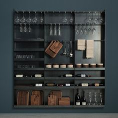 Shelving in iron sheet, designed for the kitchen and the living area. It has slots designed for glass chalices and wooden supports on which chopping boards and cans, created specifically for the Sider line, as well as cutlery holders, bottles and any other kind of object can be placed.