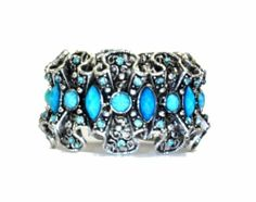 "Richa Blue Cuff Bracelet Outrage Fashion. $29.99. Material: Metal and plastic and crystals. Length: 2.9"". Color: Aqua blue"