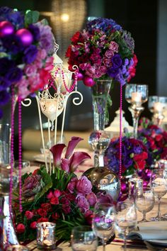 Beautiful Wedding Table Setting ~ A combination of lilac equadorian roses, purple hydrangeas, lisianthus, carnations, and fuchsia roses are key elements to this this setting