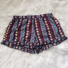 Cute Festival Shorts In good condition. Has elastic waist and ruffle at the bottom. Bundle and save 20% on your purchase Shorts