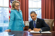 """Secretary of State Hillary Rodham Clinton watches as President Barack Obama signs a Presidential memorandum, """"Coordination of Policies and Programs to Promote Gender Equality and Empower Women and Girls Globally,"""" in the Oval Office, Jan. 20, 2013. (Official White House Photo by Pete Souza)  This official White House photograph is being made available only for publication by news organizations and/or for personal use printing by the subject(s) of the photograph. The photograph may not be…"""