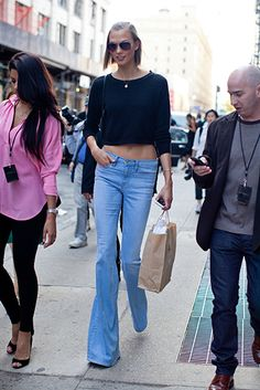 Karlie Kloss in cropped top & flared jeans #denim #pants | street style #fashion