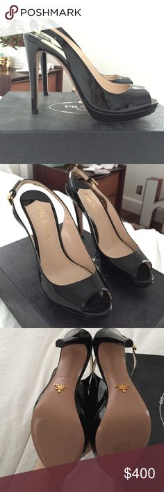 prada peep toe slingback sandal black patent prada peep toe slingback sandal black. Never worn! Comes with box and a Prada shoe dust bag for each shoe- because I always ask for an extra. Outside of the box seen in photo. Has adjustable buckle and is black patent leather. Prada Shoes Heels
