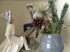 bits of Christmas greenery beside a Lladro figurine Elegant Christmas Decor, Christmas Greenery, Simple Christmas, Christmas Decorations, Party Planning, Interior Design, Easy, Home Decor, Figurine