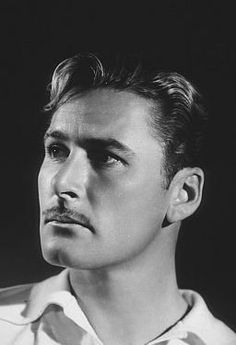 Errol Flynn photos, including production stills, premiere photos and other event photos, publicity photos, behind-the-scenes, and more.