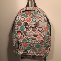O'neill Backpack Beige backpack with hearts and peace signs, used only a handful of times for trips! Great for school! O'Neill Bags Backpacks