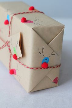 Turn your finger prints into cute tiny reindeer homemade gift wrap
