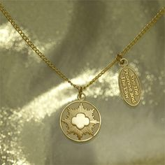 """Fashionable Gold Award necklace with two goldtone charms. One 3/4"""" Gold Award symbol charm with """"Girl Scout Gold Award"""" inscribed on back; the other 3/4"""" oval charm inscribed with """"Live The Promise and The Law"""". 18"""" length. $12.00"""