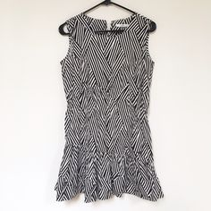 Black and white geometric shift dress!! Geometric shift dress from when I visited Korea!! Only worn once. Comes with a brown braided belt. Fits a size small or 4 Zara Dresses Mini