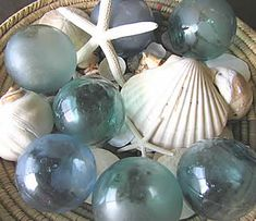 fishing float coastal glass and white seashells for a lovely table decoration